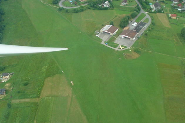 'Turnpoint photo' of the grass glider runway and hangar on the hillside at Miedzybrodzie Zywieckie, Poland.