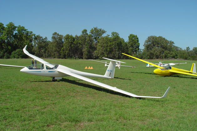Southern Cross Gliding Club's DG-1000 VH-DGI at Camden airfield, along with the club's brilliantly painted ASK-13.