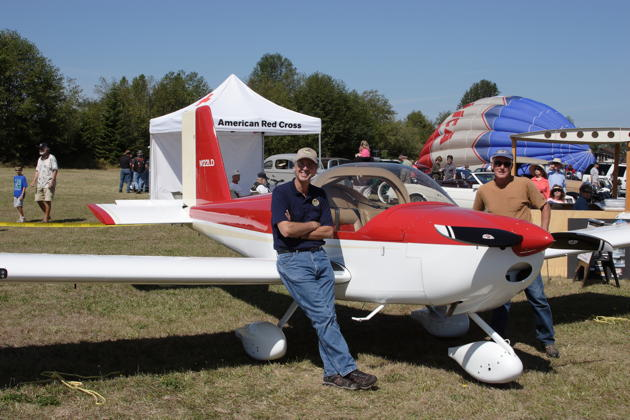 Dan Masys on the wing of his RV-12 at the Sequim Valley airport.