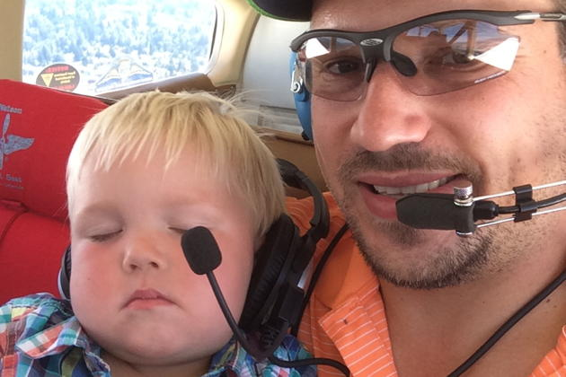 Nathaniel aloft on his first flight in 3DC, and asleep on David's warm lap! Photo by David Kasprzyk.