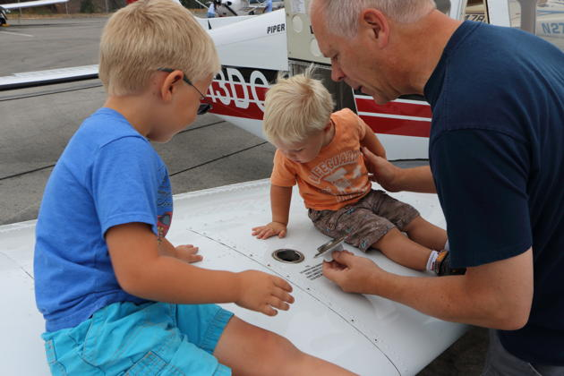 Alex and Nathaniel checking fuel level while pre-flighting the Warrior. Photo by Katie Kasprzyk.