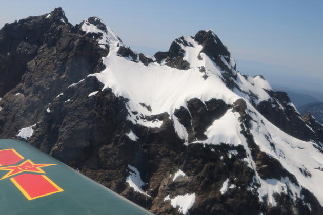 A close up view of craggy Cascade peaks from the Nanchang CJ-6 with Justin Drafts.
