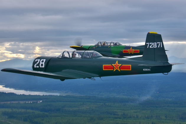 In close formation in the Nanchang with Larry Pine's CJ-6 during the Bremerton formation clinic, near Hood Canal with the Olympics mountains in showers. Photo by Karyn King.
