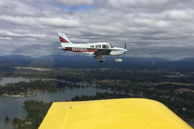 Our Warrior over Lake Tapps, in formation with the RV-7. Photo by Doug Happe.