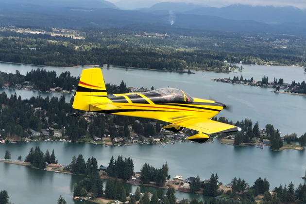 Doug and Anne Happe in their RV-7 over Lake Tapps. Photo by Mary Kasprzyk.